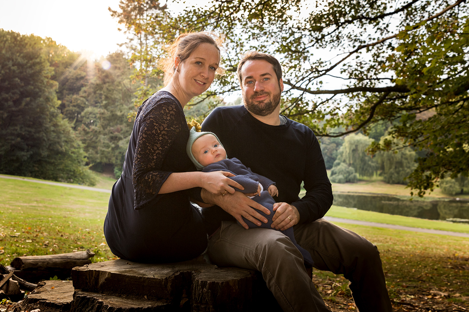 Family photo shooting in park at sunset - Autumn colors