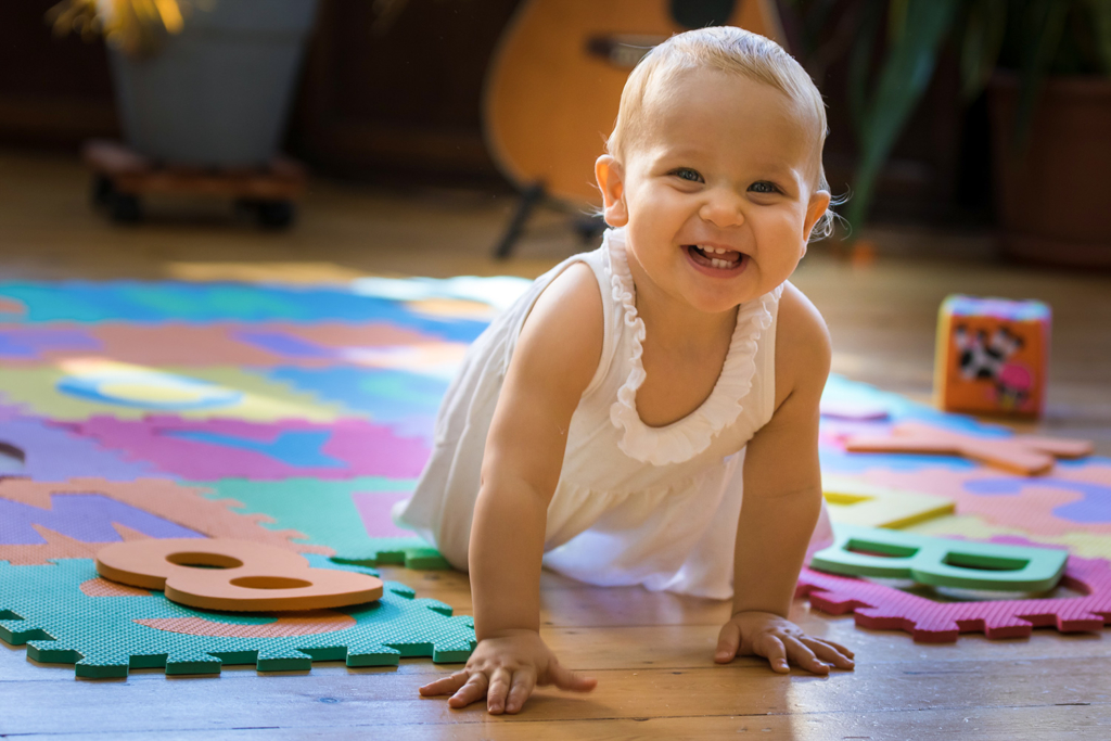 Baby crawling on a play mat photo shooting